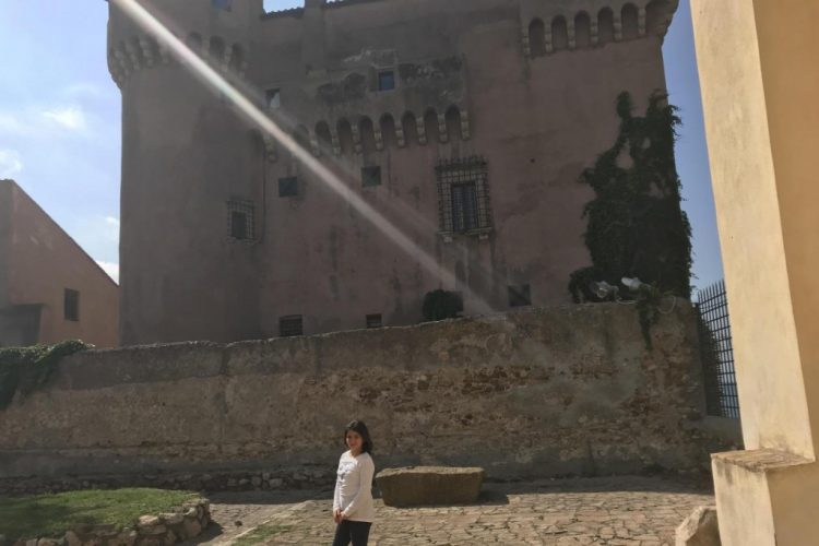 girl standing in front castle italy