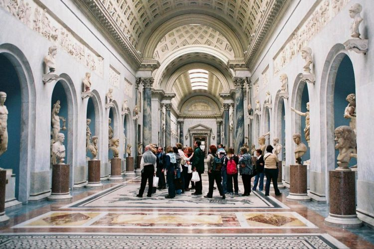 people in gallery in vatican museums